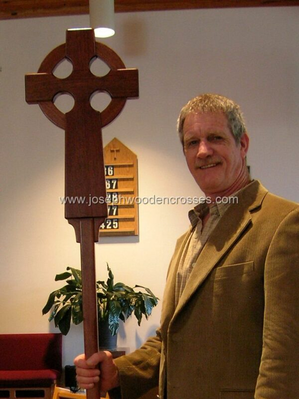 Irish Celtic Processional Cross in Mahogany with Stand closeup with joe